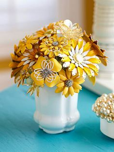 No-Fade Flower Bouquet..Create a bouquet that will last a lifetime. Use brooches and pins in a similar color scheme to craft a flower bouquet. Or round up an assortment of baubles in varying colors for a wildflower-inspired look.