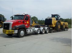 Caterpillar custom CT660 heavy haul with a Cat 980 loader on wagon