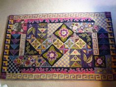 Miss Weigle rug hooking pattern by Gene Shepherd. I added Bonnie, our beloved cat of 17 yrs - hooked by Barbara Springer