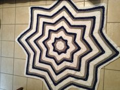 "I love the 8 star crocheted afghan pattern!  This one is a beautiful Dallas Cowboy afghan that a special fan requested.  It was inspired by one I saw on Crochet Dad Ramblings.  Here is a link to that pattern:  http://www.ravelry.com/patterns/library/9-pointed-star-round-ripple  .   I do recommend using stitch markers in the ""valleys"" of the ripple.  Otherwise, it's easy to crochet right over them! Have fun - this one is easy and fun to work!"