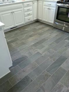 modern farmhouse kitchen. gray tile floors, white cabinets