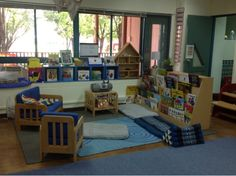Nice large, cozy area for reading that is well defined and allows for multiple displays of books. I might drape something from the ceiling or windows to enhance cozy feeling. Classroom Layout, Classroom Setting, Classroom Design, Classroom Organization, Classroom Ideas, Learning Spaces, Learning Environments, Preschool Reading Area, Kindergarten Inquiry