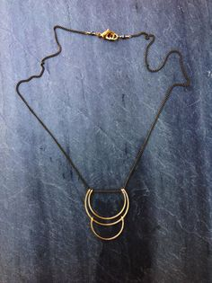 ~Small Planets Necklace - by Loop Jewelry~ Part of the Loop Jewelry Geometric line, this quaint planets necklace has been formed and