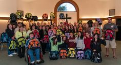 Volunteers from Northwood Middle School and Renton Christian Center display the backpacks they assembled with help from World Vision. The backpacks will go to children in need in their community. (Photo: Laura Reinhardt/World Vision)