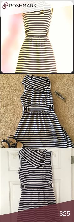 """Fabulous A- line nautical dress by ModCloth Awesome nautical inspired navy and white A-line dress. Dress had stylish touches like a foldover collar, embellished waistband, and decorative buttons, this dress is sure to turn heads. Easy to move in and great for traveling. Size is medium but fits more like a small. Perfect with flip flops/sandals, wedges or even heels for a more dressy look. Only worn a few times. Excellent condition. Shoulder to hem 33"""" Underarm to underarm 16.5"""" Waist when…"""