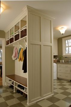 Love this organization idea. This will be in my house one day.   Mud Room @ good idea for sep the room entry-laundry/mud !