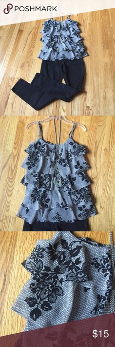 *NEW PRICE* Black floral Camisole/ strapless top. This flirty tank top is perfect for a night on the town! With its flowy layers of material, it's ready to dance with you! Black and white with silver threads throughout, adding just a glimmer of glam!! Worn once and almost brand new. Excellent condition. Candie's Tops Camisoles