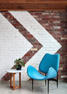 In this modern house, a white artistic element was painted onto the brick.