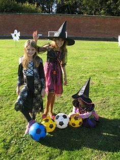 Three little witches playing Halloween 'Phantom Football' in the Walled Gardens at Holkham. www.holkham.co.uk