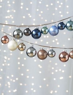 Really good idea to make a garland with glass ornaments and put up high away from little hands! @marblevein