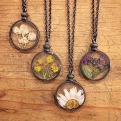 A personal favorite from my Etsy shop https://www.etsy.com/listing/265937127/pressed-flower-necklace