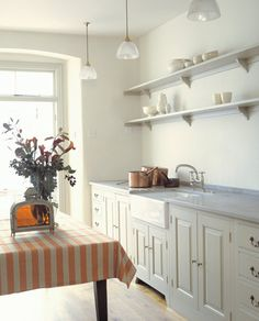 white Plain English Georgian style kitchen via Atticmag, open shelving kitchen storage, open shelves