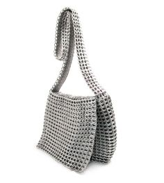 This is expensive, $190, for a bag made out of soda pop tabs.  This is the design I would want to make... just need to find instructions to pull it off.