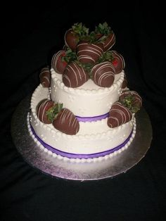 Buttercream wedding cake with chocolate covered strawberries.