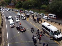 Shootout on busy M1 | The M1 highway in Johannesburg was closed to traffic today following a shootout between police and suspected criminals in Killarney. | YASEEN THEBA @Yaseen Mohamed Theba - Paramedics on the scene!