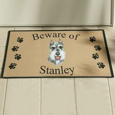 """Linda Picken Dog Breed Doormat - A Personal Creations Exclusive! We'll reproduce your favorite breed on a quality doormat. Mat says """"Beware Of"""" and we add any name, up to 10 characters. Features a polyester surface and a nonslip backing. Indoor or outdoor use. Cleans easily with soap and a hose."""