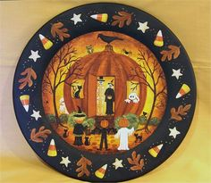PLEASE NOTE: THIS ITEM IS MADE TO ORDER: Each plate is individually hand painted and the one you receive may vary slightly from the one pictured.  The plate will be painted and shipped within three weeks of the date it was ordered. I will notify you as soon as it has been shipped.  A large wooden plate has been hand painted with my original Halloween folk art design. Its Halloween and a witch and skeleton stand at the door of their Pumpkin House handing out candy to trick or treaters…