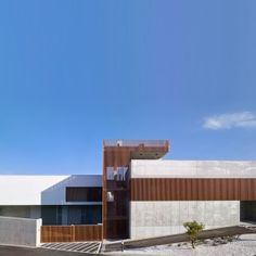 Concrete+and+slatted-timber+morgue+by+AE+Arquitectos+overlooks+a+Spanish+harbour