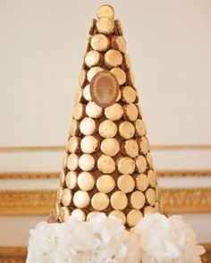 Inspired by Marie Antoinette, this couple presented a tower of gold filigree-covered macarons from Ladurée at their destination celebration in France.