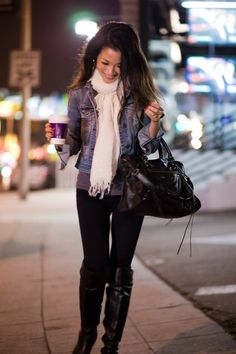 Cropped jean jacket, dark grey tee, black pants, boots and cream scarf