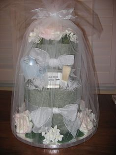 Wedding shower gift idea....towels and utensils from their registry made into a cake.