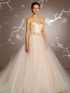I love this Lazaro wedding dress! It comes in blush and a white. I love the ballgown style
