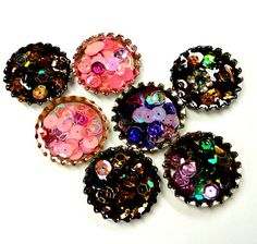 Resin and sequins.   Bottle cap jewelry and learning pieces :)