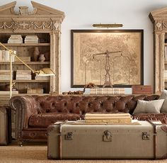 "76"" Kensington Leather Sofa $3495  Restoration Hardware  A masterful reproduction by Timothy Oulton of the classic Chesterfield style, our sofa evokes the grand gentlemen's club tradition. Features deep hand-tufting&rolled arms. Detailed with 1500 hand-hammered brass studs&85 buttons. Upholstered in supple leather.  ...soft, worn, brown leather sofas scream ""old money,""&ive always had a soft spot for them. this is in my dream library, along w/the antique replica map of Paris&steamer trunk…"