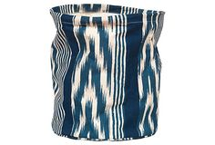 "Ikat Stripe Canvas Basket, Navy on OKL ($14 v. $22 retail) Made of: cotton canvas 12"" x 13"" Color: blue/white/teal ""Storage doesn't have to be boring. This playful ikat canvas basket...comes complete with a water-resistant lining that wipes clean. Use it as a wastebasket or to store toys, blankets, or crafts. Rockflowerpaper's...artists and businesspeople love transforming proprietary art and design created in their San Anselmo, CA, studio into sophisticated, strong and functional products."""