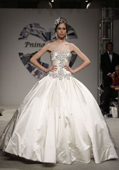Google Image Result for http://bagsview.com/wp-content/uploads/2012/03/over-top-wedding-dresses-from-bridal-runway-enormous-skirts-1-349x500.jpg