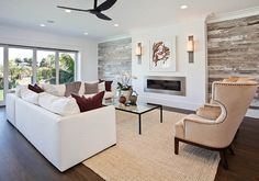 Reclaimed barnwood wall adds personality to this living room