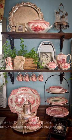 Kitchen display of red dishware collection