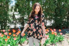 Shirt by Cleo Madison! Modest fashion blogger Modest Goddess styles a black floral top with gingham crops for a cute modest spring outfit by the tulips.