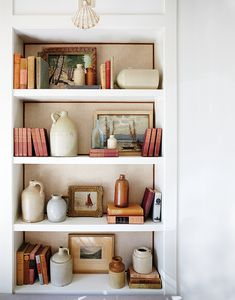 Open shelves in the living room allow designer Silvana D'Addazio to display her collections of crockware jugs and vases and old crystal. Shelves, House Interior, Global Decor, White Home Decor, Interior, Room Decor, Home Decor, Classic Decor, Room Inspiration