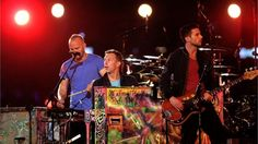 (R-L) Guy Berryman, Chris Martin and Jonny Buckland of Coldplay perform on the central Sundial Stage during the Paralympic GamesClosing Ceremony.