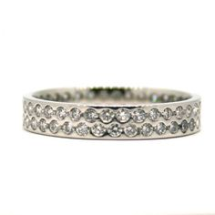 This full eternity ring, set with a double row of brilliant round diamonds, is the perfect complement to any wedding band and engagement ring! www.neweysjewellers.co.uk