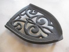 antique iron trivet by kristiemalivindi on Etsy, $10.00