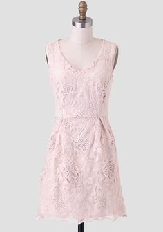 Yorktowne Embroidered Dress  An elegant ensemble for a daytime party, this exquisite beige dress features mesh inserts is adorned with floral embroidery and cutouts. Perfected with a scalloped hem.
