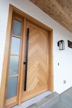 Modern farmhouse style custom home. Custom built herringbone oak front door with matte black hardware. Modern Entrance Door, Modern Exterior Doors, Modern Front Door, Front Door Entrance, House Front Door, Modern Porch, Front Porch, Front Door Hardware, Wood Front Doors