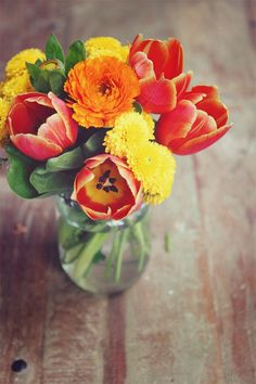 Pretty Bouquet of Tulips & yellow & orange Marigolds.