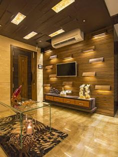 TV Wall Mount Ideas – Relaxing in a living room while enjoying your favorite TV shows with your family is such a brilliant idea especially after spending the whole day . Lcd Wall Design, False Ceiling Design, Lcd Unit Design, Drawing Room Wall Design, Tv Unit Interior Design, Interior Design Business, Bedroom Tv Unit Design, Small Tv Unit, Lcd Units