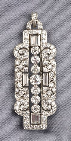 Art Deco Platinum, and Diamond Pendant/Brooch, set throughout with transitional-, baguette-, and single-cut diamond melee weighing approx. 4.55 cts., 10.4 dwt, lg. 2 1/4 in., A. Stowell box.
