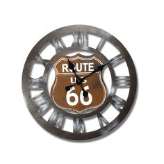 """Furnistar Vintage-Inspired Retro Wall Clock """"US Route 66"""". This fun vintage-looking wall clock features brushed iron with cut out roman numerals surrounding a road sign that reads US Route 66This clock is a great conversation piece for the kitchen bedroom or living room and makes a wonderful housewarming wedding or anniversary gift"""