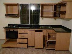 Hermosa cocina entregada, acabado en Encino Natural, con Cubierta de Granito negro