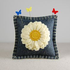 Wool Felt Pincushion / Small Pillow - Large Ivory Flower Hand Embroidered on Gray. $16.00, via Etsy.