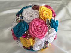 This bouquet is pink yellow and blue with a white rose base. It is decorated with some pretty brooches of high-heeled shoes, music notes, handbags and exotic animals of various colours.  All bouquets can be reproduced in the size and colour of your choice. Feel free to mix and match ideas to make your bouquet more individual. Corsage, MOB and Lapel pins are also available to match your colours. Contact leeann@bejewelledbridal.com.au for more information.