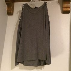 Grey Cold Shoulder Shirt Grey cold shoulder shirt. Perfect condition. Worn a handful of times. Size L. The front side of the cold shoulder part has bough white and grey beads, the back of the cold shoulder part has just white beads. Long sleeves. Cute comfy top. 65% Rayon. 35% Polyester. Tops