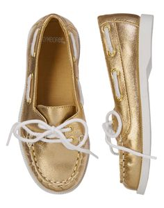 Style is on deck in our shimmering gold boat shoe. Metallic exterior adds a girly touch to a nautical look. Crisp white laces and gold grommets make our shoes a fashionable favorite.