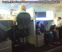 What do you mean that's not how you use standing desks? That's totally how your supposed to use them!