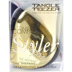 Gold Tangle Teezer detangling hairbrushTangle Teezer gold detangling compact styler.